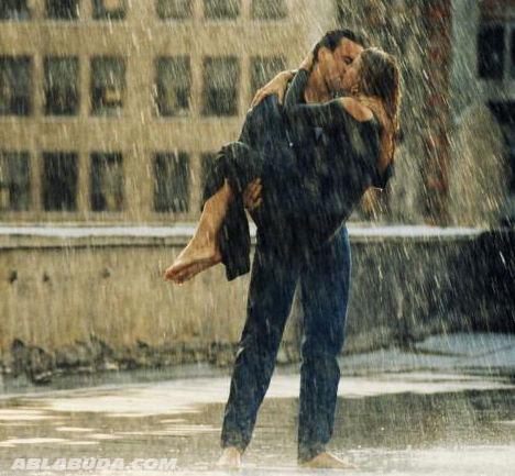 Romantic Couple Kissing in Rain